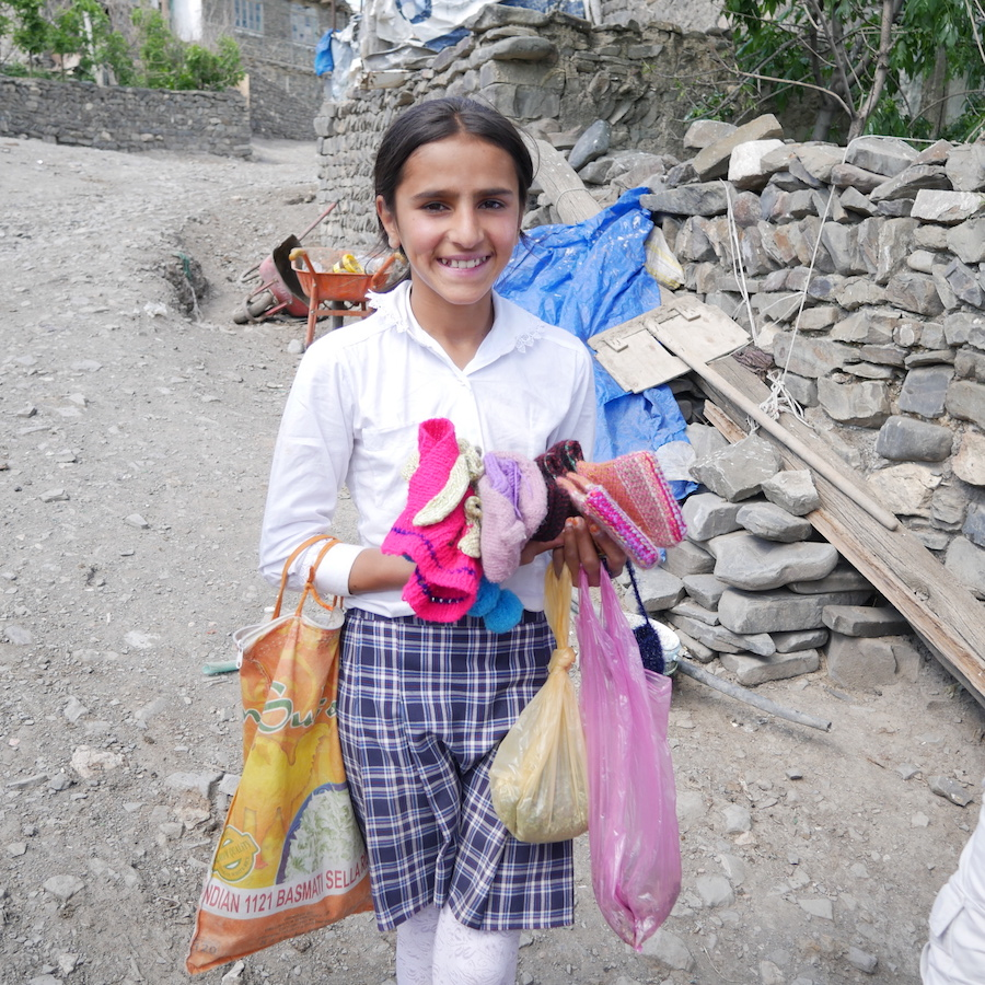 A young seller of handknitted socks in Khinalig village, Azerbaijan | Buyuran Tours