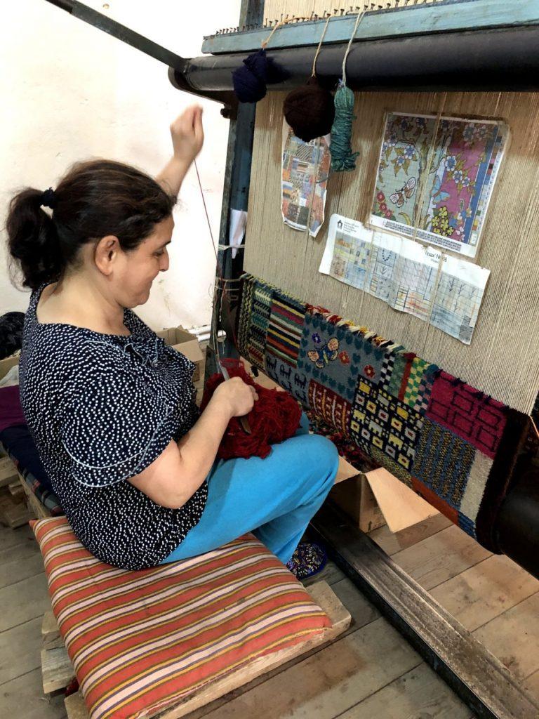 Carpet weaver in Ismayilli, Azerbaijan | Feride Buyuran Tours